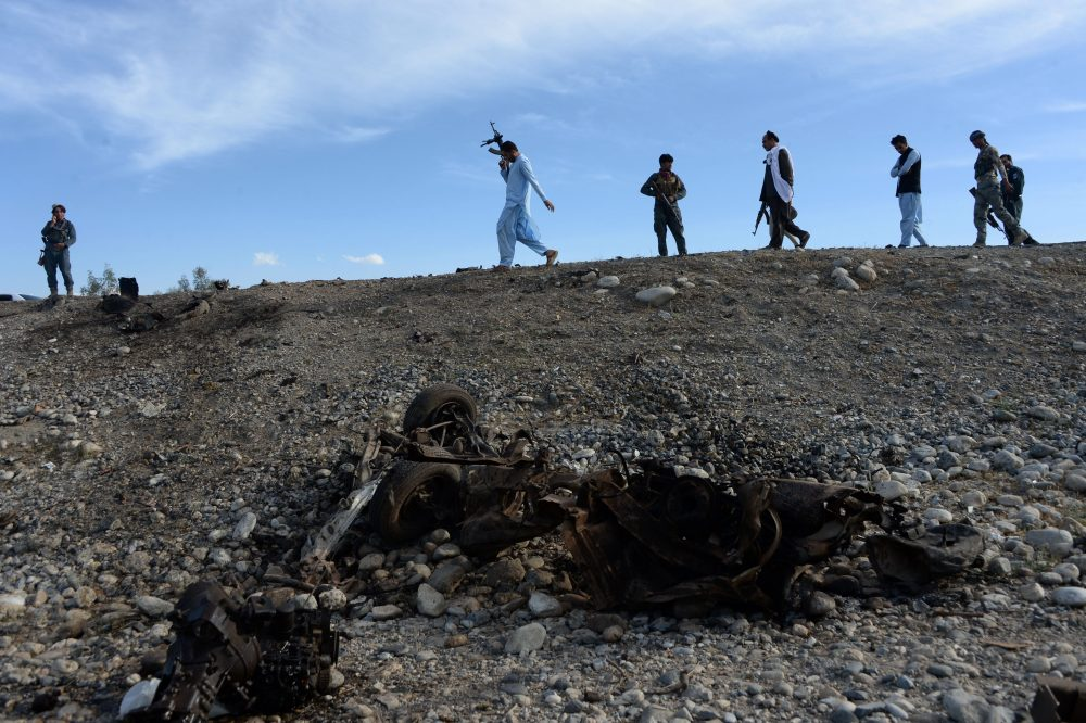 Afghan security forces inspect the site of a suicide attack targeting foreign troops in the Bati Kot district of Nangarhar province on May 1, 2017. (Noorullah Shirzada/AFP/Getty Images)