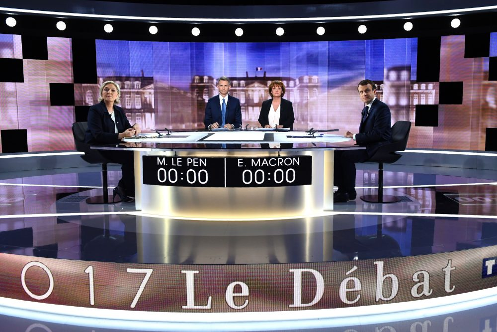 French presidential election candidates Marine Le Pen (left) and Emmanuel Macron (right) pose prior to the start of a live televised debate on May 3, 2017. (Eric Feferberg/AFP/Getty Images)
