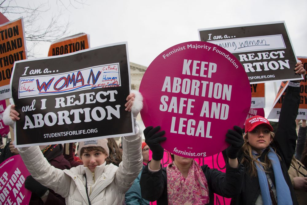 A pro-abortion rights activist (center) demonstrates in the middle of anti-abortion activists as they demonstrate in front of the Supreme Court during the March For Life in Washington, D.C., in January 2017. At least half of all states in the U.S. have imposed restrictions on abortion in the decades following Roe v. Wade, the 1973 Supreme Court decision recognizing a woman's right to abortion, according to the Guttmacher Institute. (Jim Watson/AFP/Getty Images)