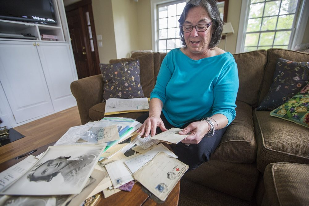 Betsy Fermano opens a plastic bag containing letters from Ernest Hemingway to her grandmother Frances Elizabeth Coates. (Jesse Costa/WBUR)