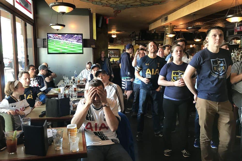 Boston fans of the London soccer club Tottenham Hotspur watch a tense moment of a big match at The Kinsale. (Jeremy D. Goodwin for WBUR)