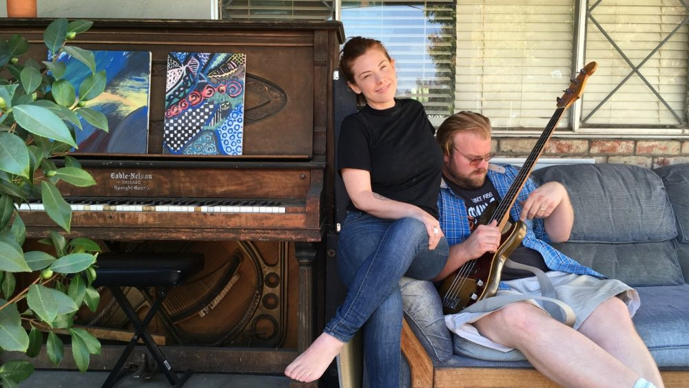 Blues musician and producer Kid Andersen and his wife, singer Lisa Leuschner, hang out on the porch outside their home in San Jose, California. (Rachael Myrow/KQED)