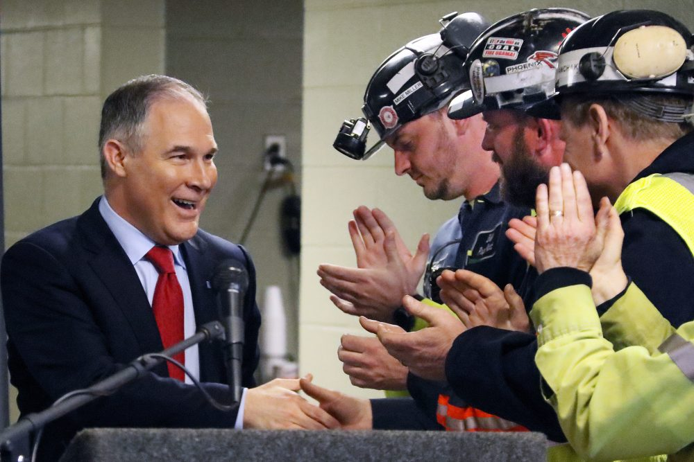 Environmental Protection Agency (EPA) Administrator Scott Pruitt, left, shakes hands with coal miners during a visit to Consol Pennsylvania Coal Company's Harvey Mine in Sycamore, Pa., in April. (Gene J. Puskar/AP)