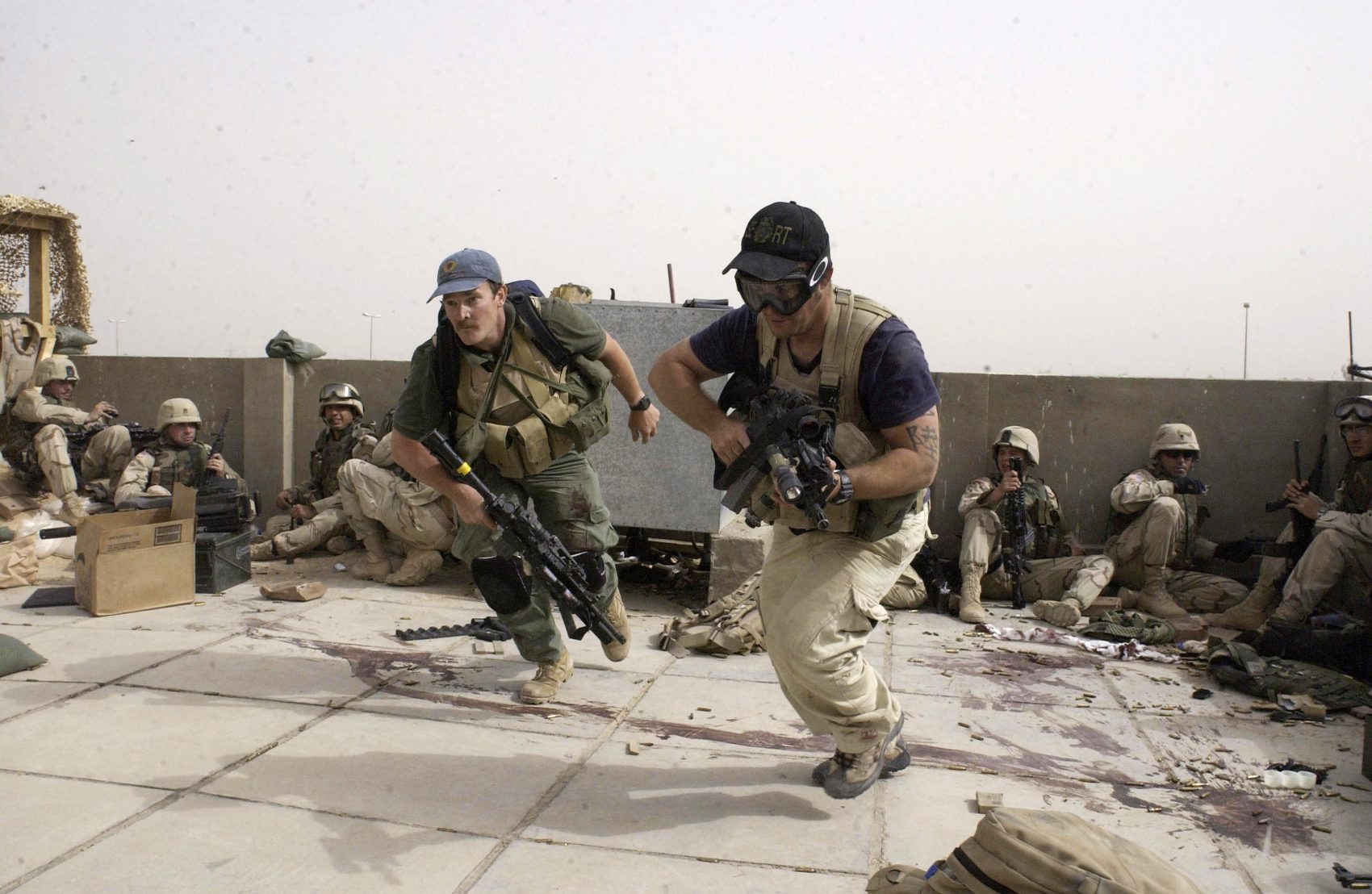Contractors working for Blackwater USA take part in a firefight in the Iraqi city of Najaf in April 2004. (Gervasio Sanchez/AP)