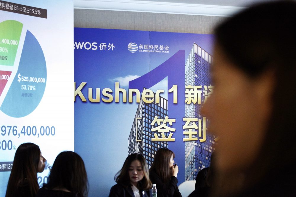 Chinese staff wait for investors at a reception desk during an event promoting EB-5 investment in a Kushner Companies development at a hotel in Shanghai, China, Sunday, May 7, 2017. (AP)