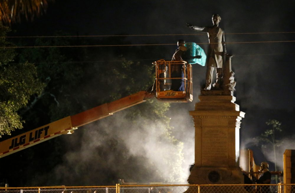 Workers prepare to take down the Jefferson Davis statue in New Orleans, Thursday, May 11, 2017. This was the second of four Confederate monuments slated for removal in a contentious process that has sparked protests on both sides. (Gerald Herbert/AP)