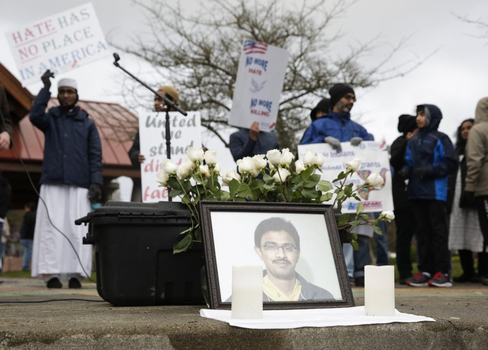 A photo of Srinivas Kuchibhotla, the 32-year-old Indian engineer killed at a bar in Olathe, Kansas, is pictured during a peace vigil in Bellevue, Wash., on March 5, 2017. (Jason Redmond/AFP/Getty Images)