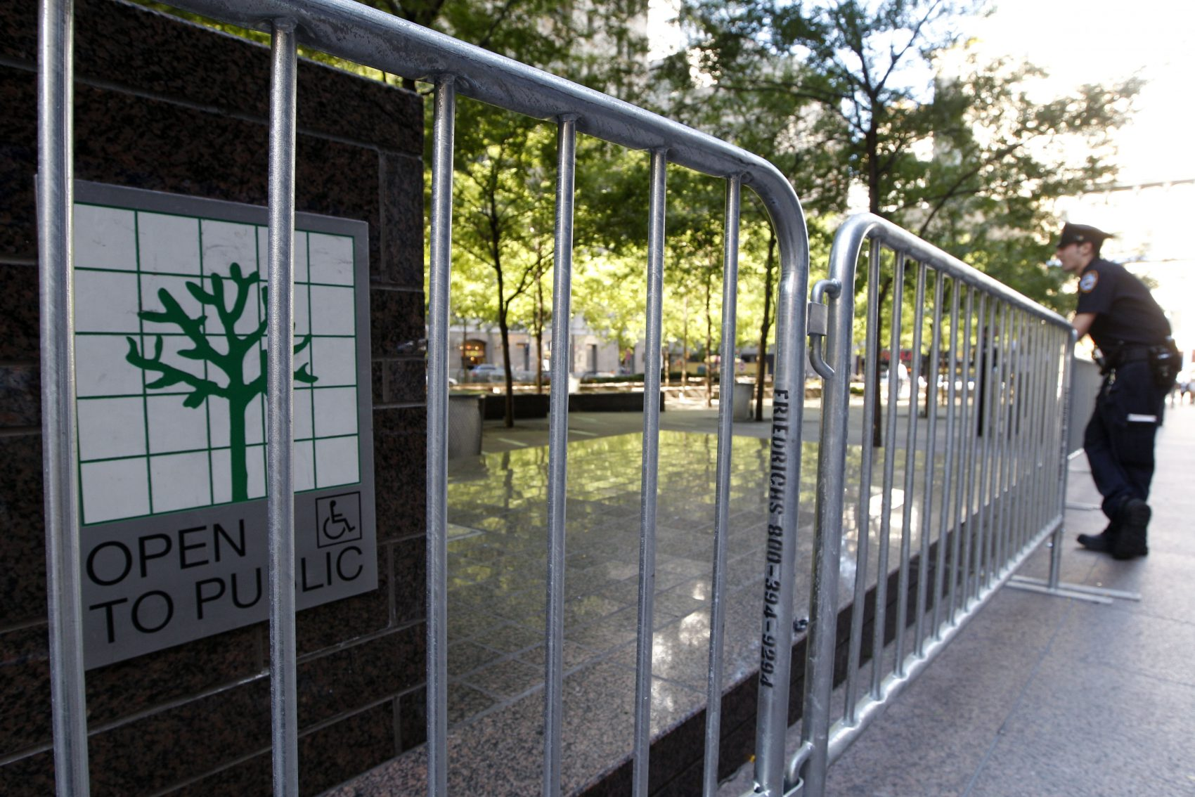 A police officer stands guard outside metal barricades surrounding Zuccotti Park, Saturday, Sept. 15, 2012, in New York, during Occupy Wall Street protests. The park is a privately owned public space. (Mary Altaffer/AP)