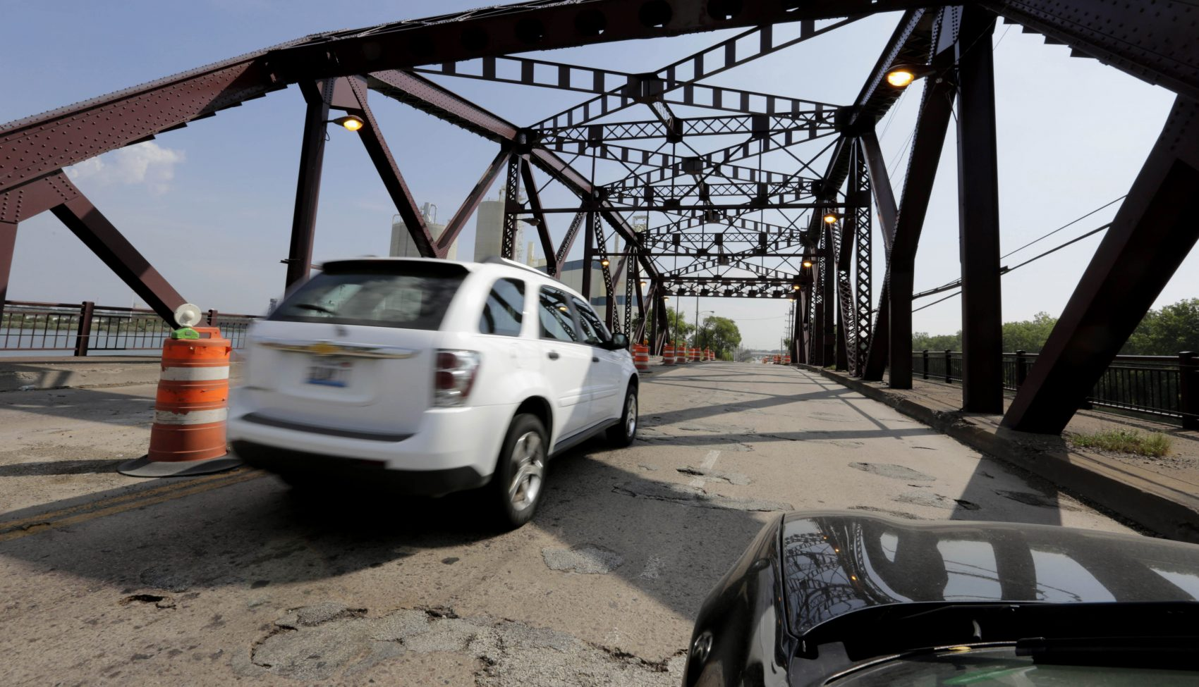 """Vehicles drive on the 130th St. bridge over the Little Calumet River in Chicago in 2013. The bridge was classified as both """"structurally deficient"""" and """"fracture critical"""" in federal data for 2012. (M. Spencer Green/AP)"""