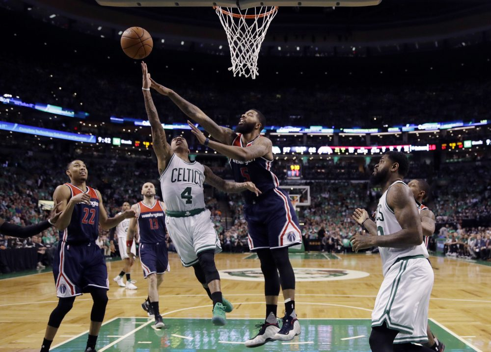 Boston Celtics guard Isaiah Thomas (4) drives against Washington Wizards forward Markieff Morris (5) during the fourth quarter of Game 7 of a second-round NBA basketball playoff series on Monday. (Charles Krupa/AP)