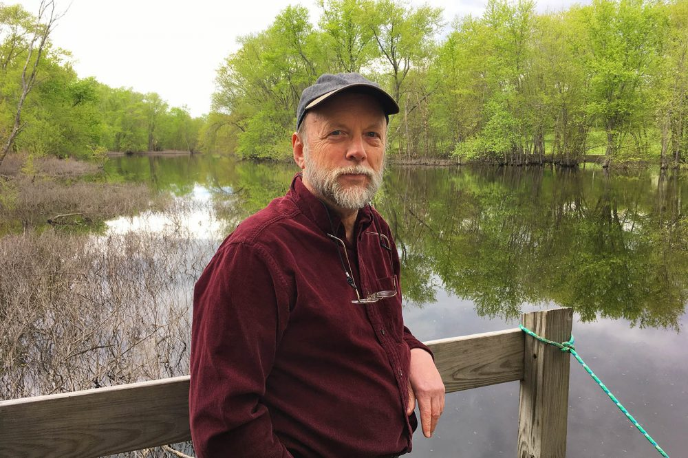 Author Robert Thorson on the Concord River. (Alex Ashlock/Here & Now)