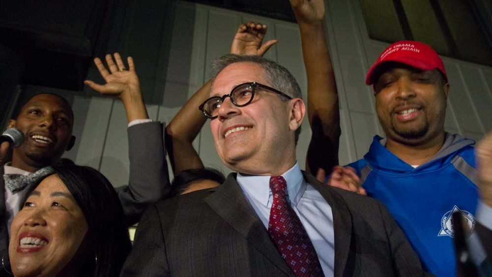 Democratic primary winner Larry Krasner takes the stage at his campaign party Tuesday night. (Kimberly Paynter/WHYY)