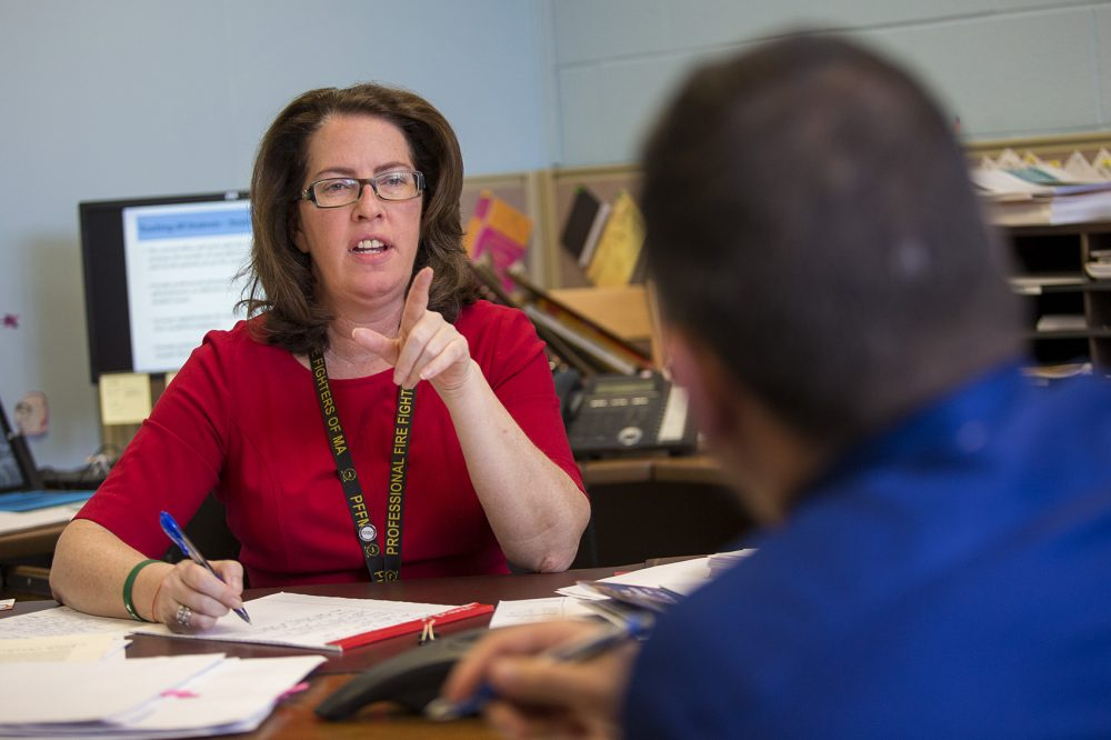 Superintendent of Revere Schools Dianne Kelly speaks with Assistant Superintendent Josh Vadala about their presentation of this year's goals to the school committee. (Jesse Costa/WBUR)