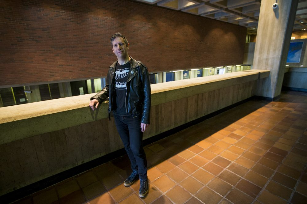 Artist Jesse Kaminsky stands in front of the space where his piece will reside.(Jesse Costa/WBUR)