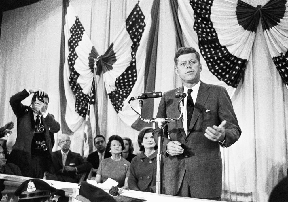 Sen. John F. Kennedy talks to newsmen, Nov. 9, 1960 at the Hyannis Armory, Mass., after his election to the presidency. (AP)