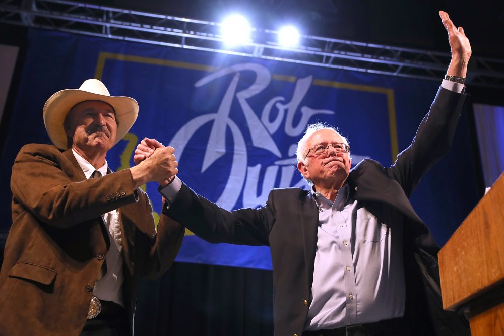 Democratic Congressional candidate Rob Quist (left) and Sen. Bernie Sanders (I-VT) greet supporters during a campaign rally on May 20, 2017, in Butte, Montana. (Justin Sullivan/Getty Images)