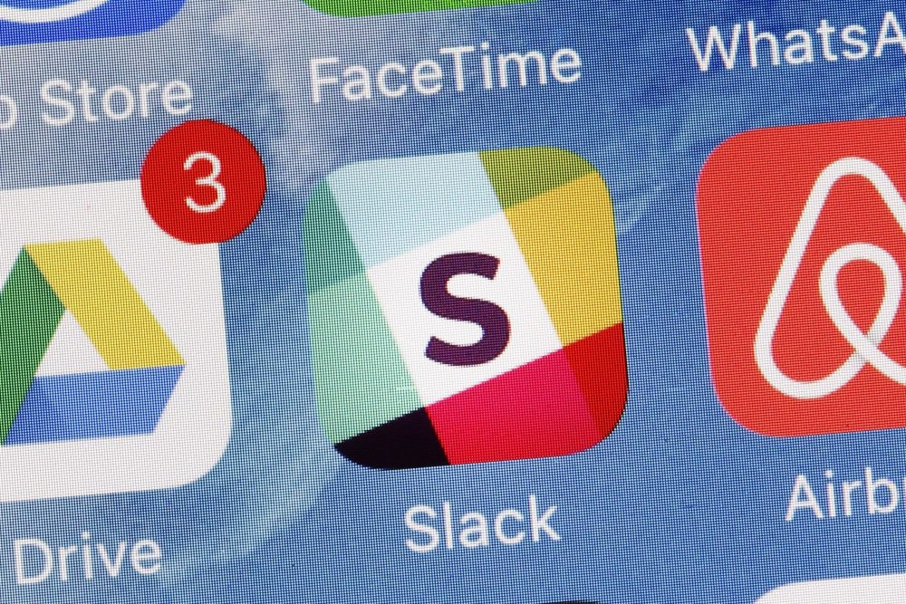 The Slack app is displayed on a mobile phone, Tuesday, Jan. 31, 2017, in New York. Slack Technologies is hoping to convert more big businesses to its online business messaging service by making it easier for workers in different departments to communicate with each other. (Mark Lennihan/AP)