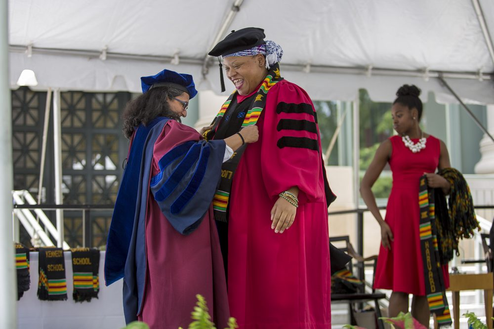 Arts and sciences graduate Funlayo Wood receives her stole at Harvard's first Black Commencement. (Jesse Costa/WBUR)