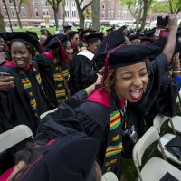 Black students at Harvard University held the university's first-ever Black Commencement on Tuesday. Here, graduates celebrate after the ceremony. (Jesse Costa/WBUR)