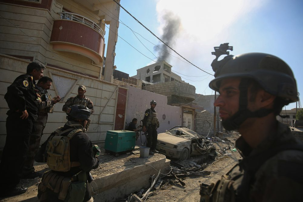 Smoke billows as Iraqi Counter-Terrorism Services (CTS) advance in West Mosul's Al-Najjar neighborhood on May 22, 2017, during the ongoing offensive to retake the area from Islamic State group fighters. (Ahmad al-Rubaye/AFP/Getty Images)