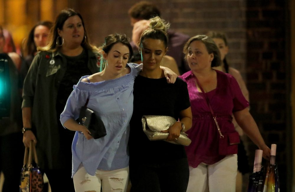Police escort members of the public from the Manchester Arena on May 23, 2017 in Manchester, England. (Christopher Furlong/Getty Images)