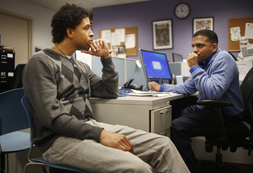 """In this Thursday, April 20, 2017 photo, Neftali Thomas Diaz, left, talks with his case manager, David Rodriguez, at The Fortune Society in New York. New York City is betting that Diaz and other low-level offenders like him are right about the salvation in second-chance employment. Mayor Bill de Blasio said the city will spend $10 million a year on a """"jails to jobs"""" initiative that will guarantee all Rikers inmates serving sentences of a year or less a chance at short-term employment once they do their time. (Seth Wenig/AP)"""