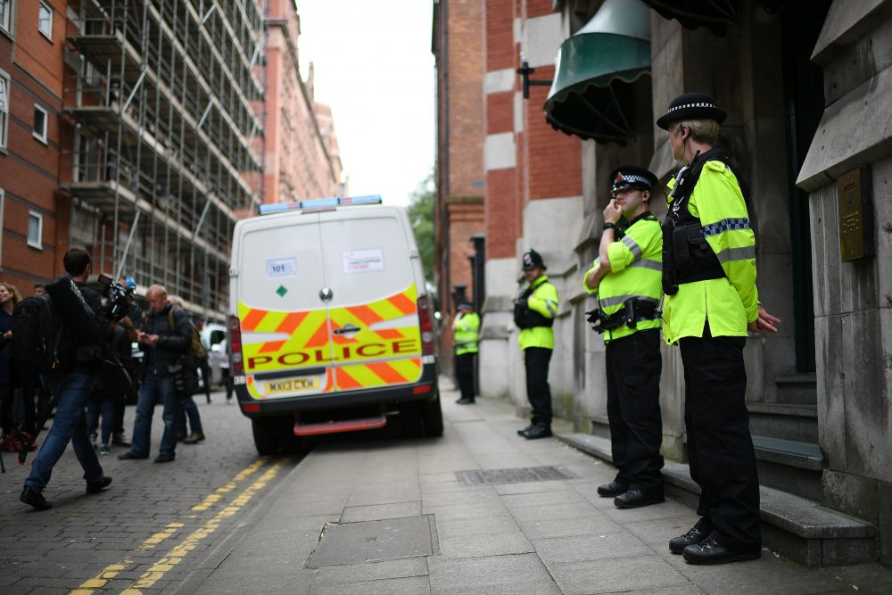 Police guard the entrance to Granby House in the city center following an armed raid, on May 24, 2017, in Manchester, England. (Jeff J Mitchell/Getty Images)
