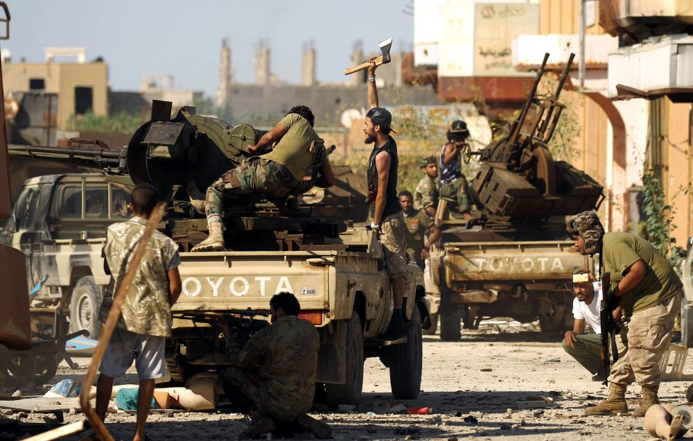 Members of the Libyan National Army (LNA), also known as the forces loyal to Marshal Khalifa Haftar, clash with jihadists in Benghazi's Al-Hout market area on May 20, 2017. (Abdullah Doma/AFP/Getty Images)