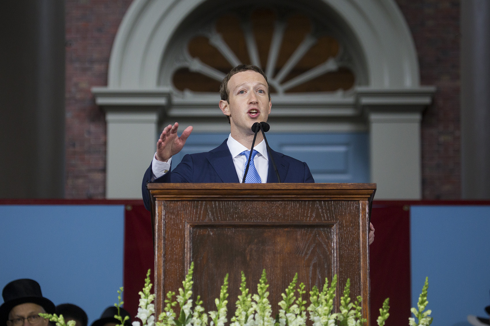 "Facebook CEO Mark Zuckerberg spoke to Harvard graduates Thursday on what he's experienced on stops along his national ""listening tour."" (Jesse Costa/WBUR)"