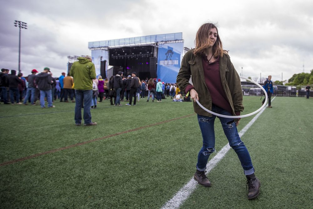 Arianna Leon, of Southwick, hula hooping during the Car Seat Headrest set Friday night. (Jesse Costa/WBUR)