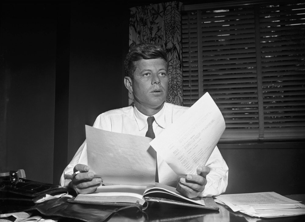 Sen. John Kennedy as he catches up on his work in his hotel suite, May 24, 1955, after returning to the capital after an eight-month absence, following an operation. (Bill Allen/AP)