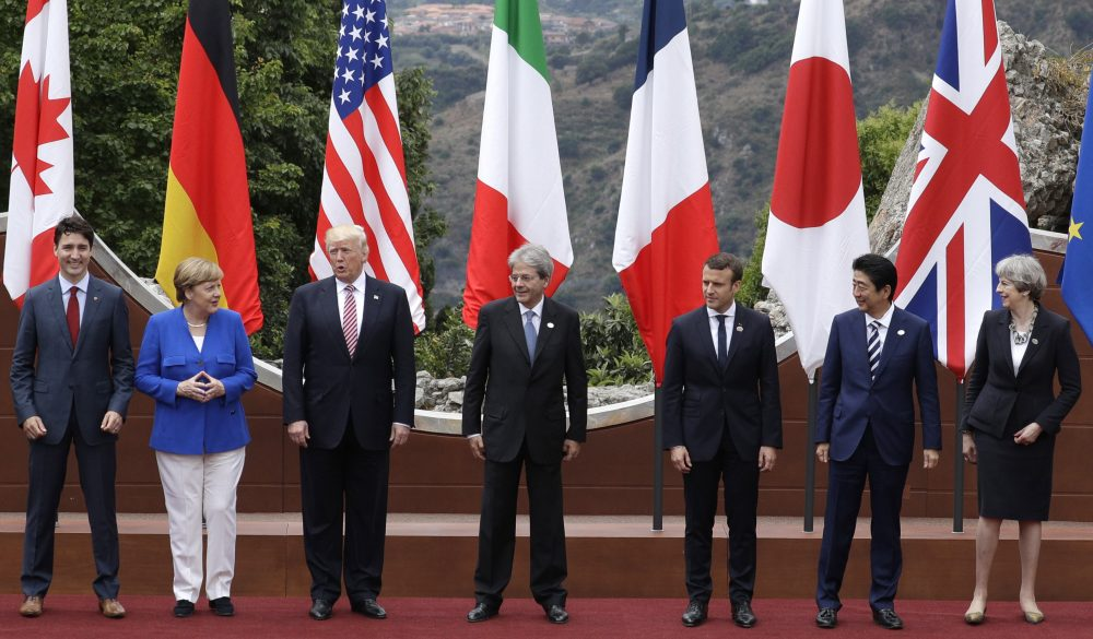 Leaders of the G-7, from left, Canadian Prime Minister Justin Trudeau, German Chancellor Angela Merkel, U.S. President Donald Trump, Italian Prime Minister Paolo Gentiloni, French President Emmanuel Macron, Japan's Prime Minister Shinzo Abe, and British Prime Minister Theresa May pose during a group photo for the G-7 summit in the Ancient Theatre of Taormina in the Sicilian citadel of Taormina, Italy, Friday, May 26, 2017. (Andrew Medichini/AP)