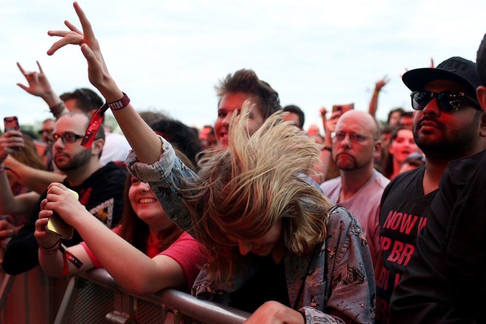 The audience dances to Cage the Elephant on Sunday. (Hadley Green for WBUR)