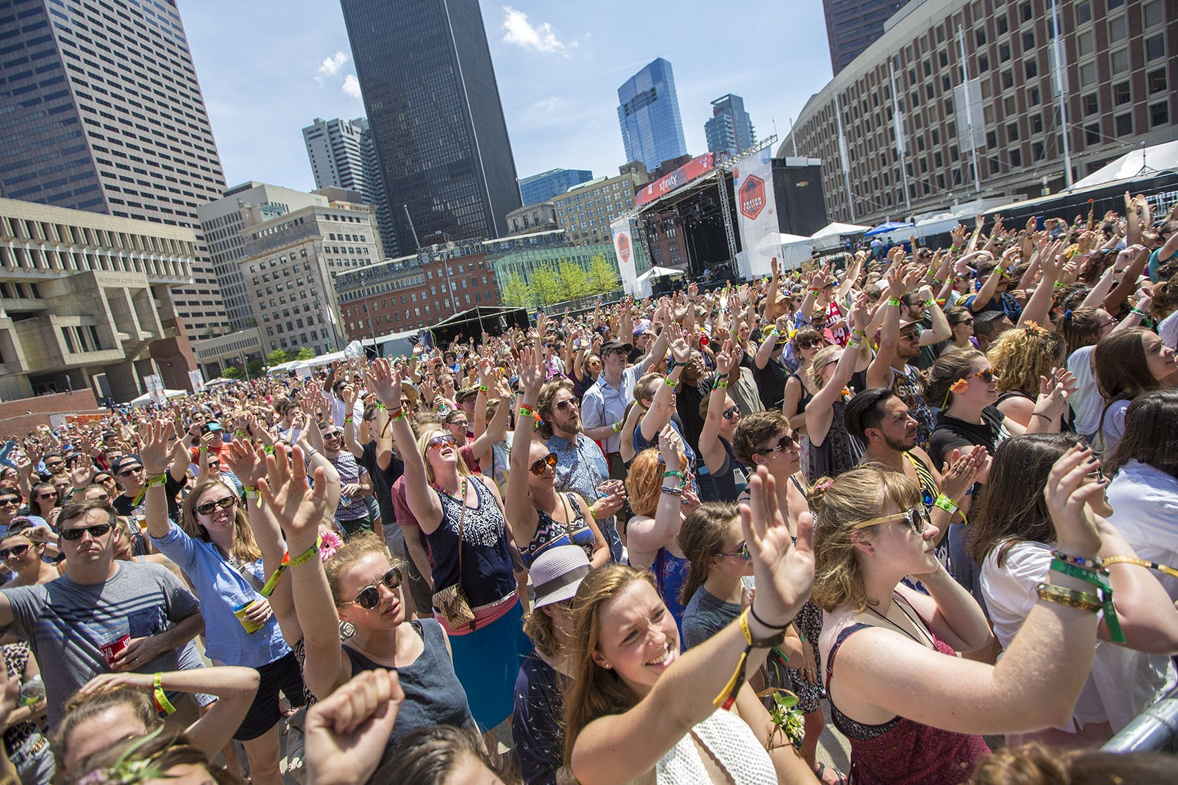 Fans cheer during Saturday afternoon concerts at Boston Calling in City Hall Plaza last May. This year, the festival is moving to greener pastures in Allston. (Jesse Costa/WBUR)