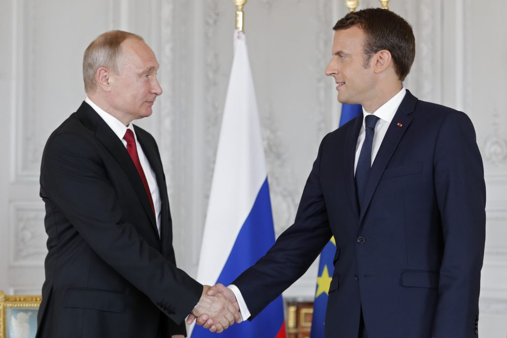 French President Emmanuel Macron (right) and Russian President Vladimir Putin shake hands during their meeting at the Versailles Palace, near Paris, on May 29, 2017. (Philippe Wojazer/AFP/Getty Images)