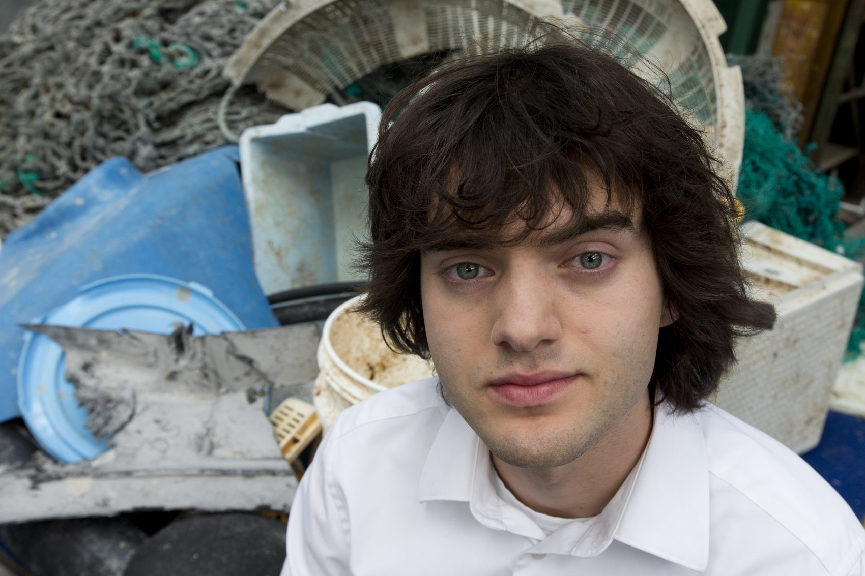 Dutch university dropout Boyan Slat, who founded the The Ocean Cleanup, poses for a portrait next to a pile of plastic garbage prior to a press presentation in Utrecht, Netherlands, Thursday, May 11, 2017. The foundation aiming to rid the world's oceans of plastic says it will start cleaning up the huge patch of floating junk known as the Great Pacific Garbage Patch within the next 12 months, two years ahead of schedule. (Peter Dejong/AP)