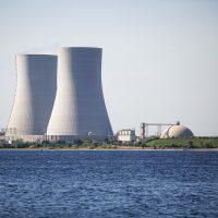 The twin cooling towers at Brayton Point Power Station in Somerset, Mass. (Jesse Costa/WBUR)