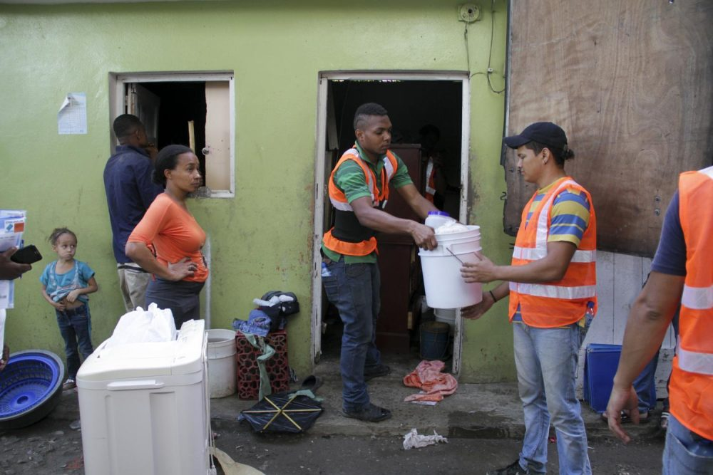 """Maria Isabel Reyes watched workers pack up her life. """"I feel nervous,"""" she said. (Mariana Dale/KJZZ)"""