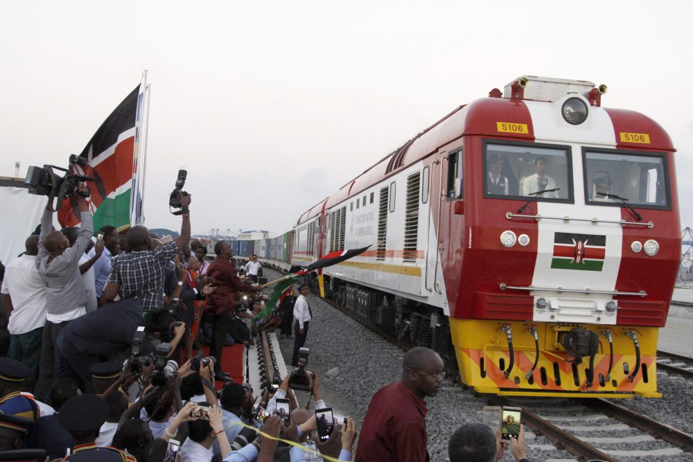 The SGR cargo train rides from the port containers depot in Mombasa, Kenya, to Nairobi, Tuesday, May 30, 2017. Kenya's president Uhuru Kenyatta opened the country's largest infrastructure project since independence, a Chinese-backed railway costing nearly $3.3 billion that eventually will link a large part of East Africa to a major port on the Indian Ocean as China seeks to increase trade and influence. (Khalil Senosi/AP)
