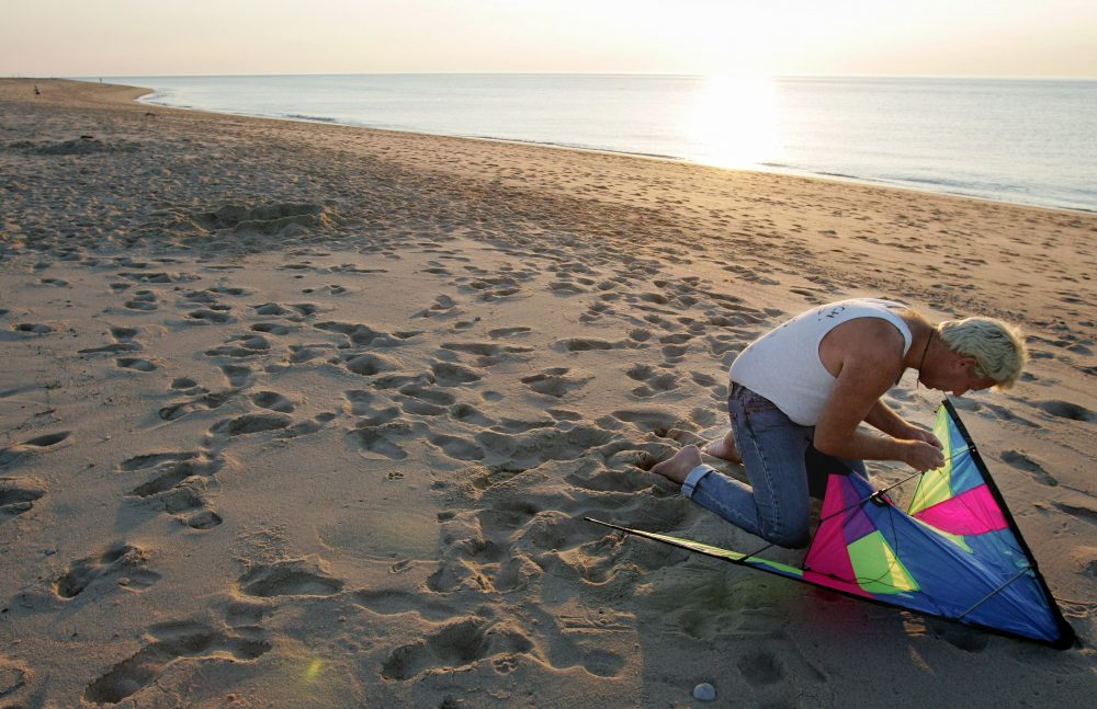 Ben Haase, of Cape May, N.J., prepares his kite for flight just before sunset on the beach at the Cape Cod National Seashore, near Provincetown, on June 13, 2006. (Steven Senne/AP)