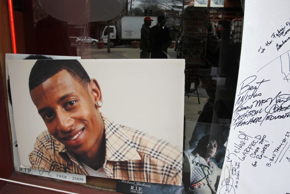 A photograph of D.J. Henry, who was shot and killed by a New York police officer in 2010, is seen in the window of a radio station in Boston's Roxbury neighborhood in 2011. (Steven Senne/AP)