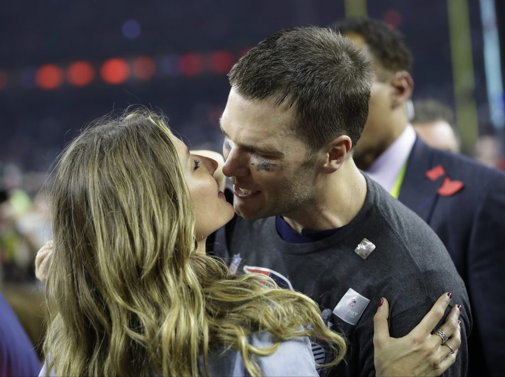 Tom Brady kisses his wife, Gisele Bundchen, after the Patriots Super Bowl win in February. (Patrick Semansky/AP)
