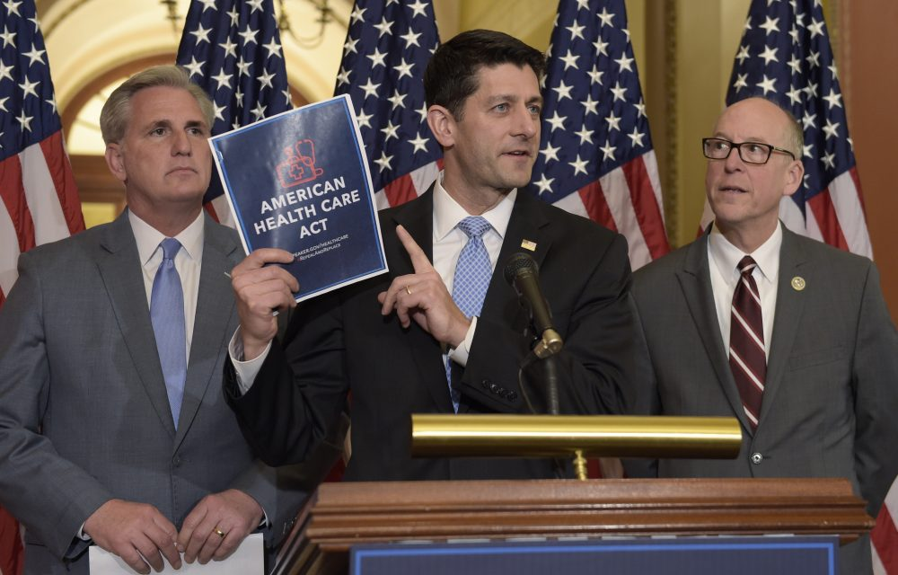 House Speaker Paul Ryan, center, standing with Energy and Commerce Committee Chairman Greg Walden, right, and House Majority Whip Kevin McCarthy, left, speaks during a news conference on the American Health Care Act in March. (Susan Walsh/AP)