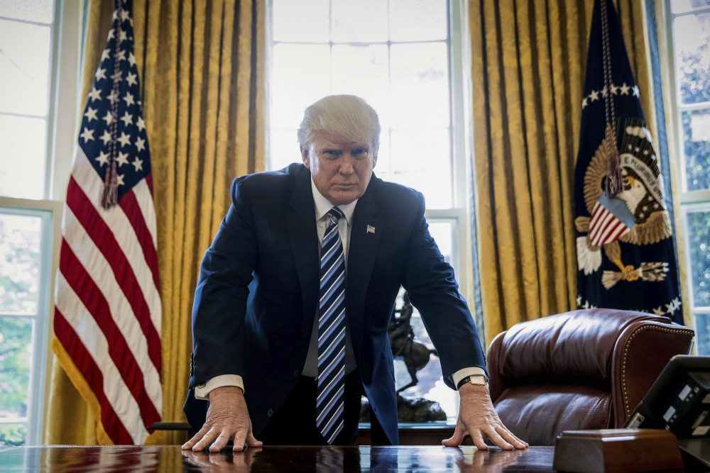 In the age of Donald Trump, writes John W. Mackey, it's time to consider the real lessons of Watergate and the pardon of Richard Nixon. In this April 21, 2017, file photo, President Trump poses for a portrait in the Oval Office in Washington. (Andrew Harnik/ AP)