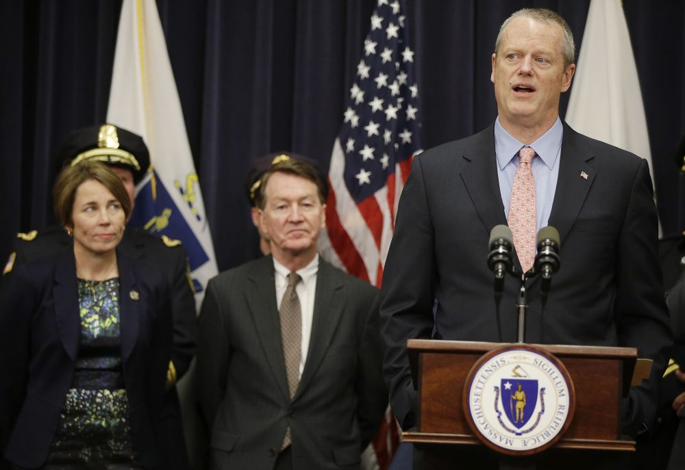 Republican Gov. Charlie Baker and Democratic Attorney General Maura Healey on Tuesday introduced legislation to modernize the state's nearly half-century-old wiretapping law to better reflect, in their view, the current criminal and technological landscape. (Stephan Savoia/AP)