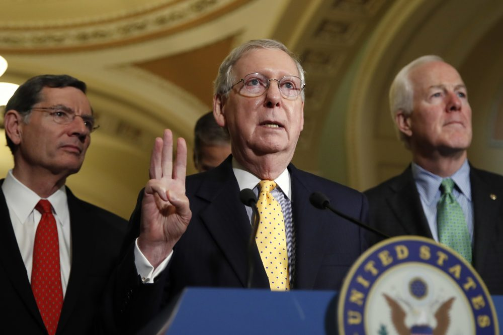 Senate Majority Leader Mitch McConnell of Ky., center, flanked by Sen. John Barrasso, R-Wyo., left, and Senate Majority Whip John Cornyn of Texas, speaks to members of the media about healthcare, Tuesday, May 9, 2017, on Capitol Hill in Washington following a policy luncheon. (Jacquelyn Martin/AP)