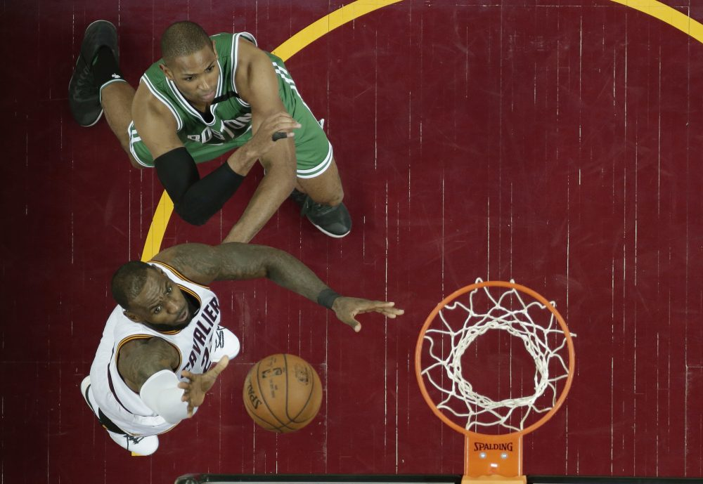 Cleveland Cavaliers' LeBron James, left, drives to the basket against Boston Celtics' Al Horford, from Dominican Republic, in the second half of Game 4 of the NBA basketball Eastern Conference finals on Tuesday in Cleveland. The Cavaliers won 112-99. (Tony Dejak/AP)