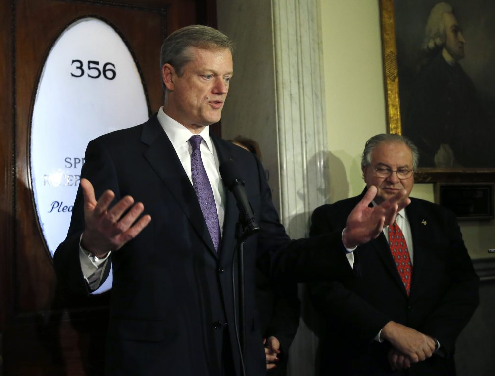 Gov. Charlie Baker and House Speaker Robert DeLeo, in a 2014 file photo (Elise Amendola/AP)