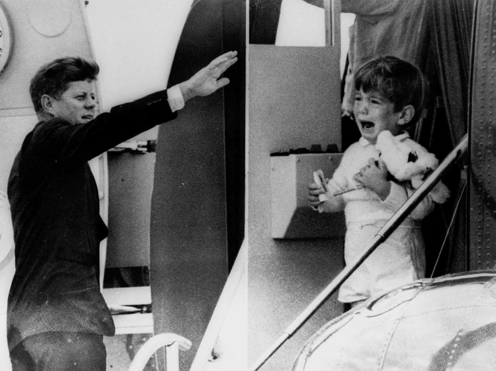 John F. Kennedy Jr. cries watching his father bid him farewell while boarding his jet for a flight to Arkansas on Oct. 3, 1963. (AP)