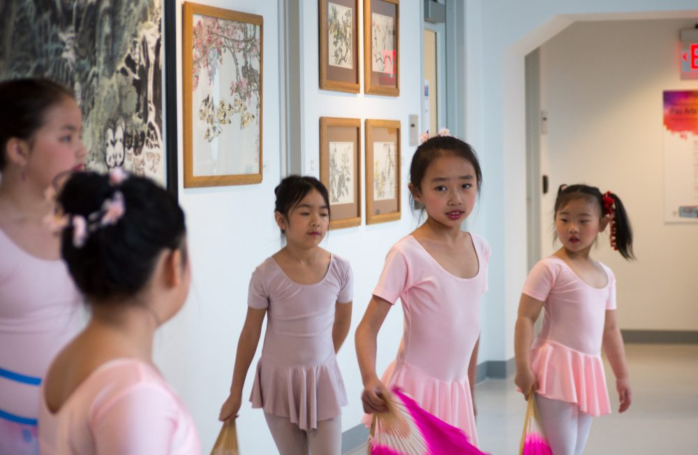 Young ballet dancers practice at the opening of the Pao Arts Center. (Max Larkin/WBUR)